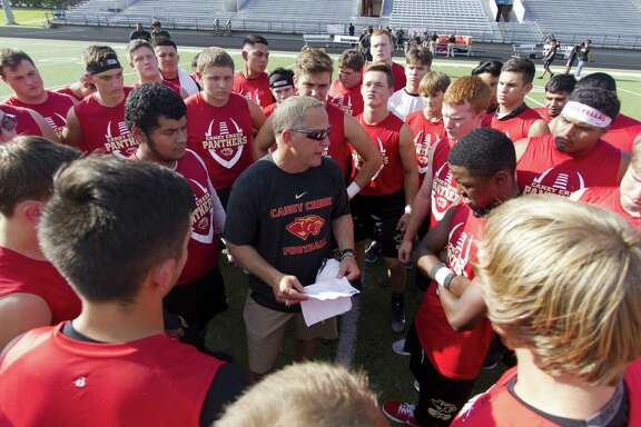 Caney Creek head coach Steve Svendsen talks with players before a non-district high school football game at Buddy Moorhead Stadium on Friday, Aug. 31, 2018, in Conroe.