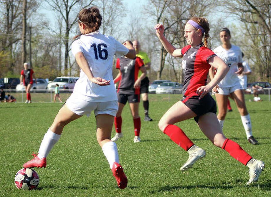Maggie Evans of Alton, right, chases down O'Fallon's Abby Burkhalter during Tuesday's Southwestern Conference game at Alton High. Alton won 1-0. Photo: Pete Hayes | The Telegraph
