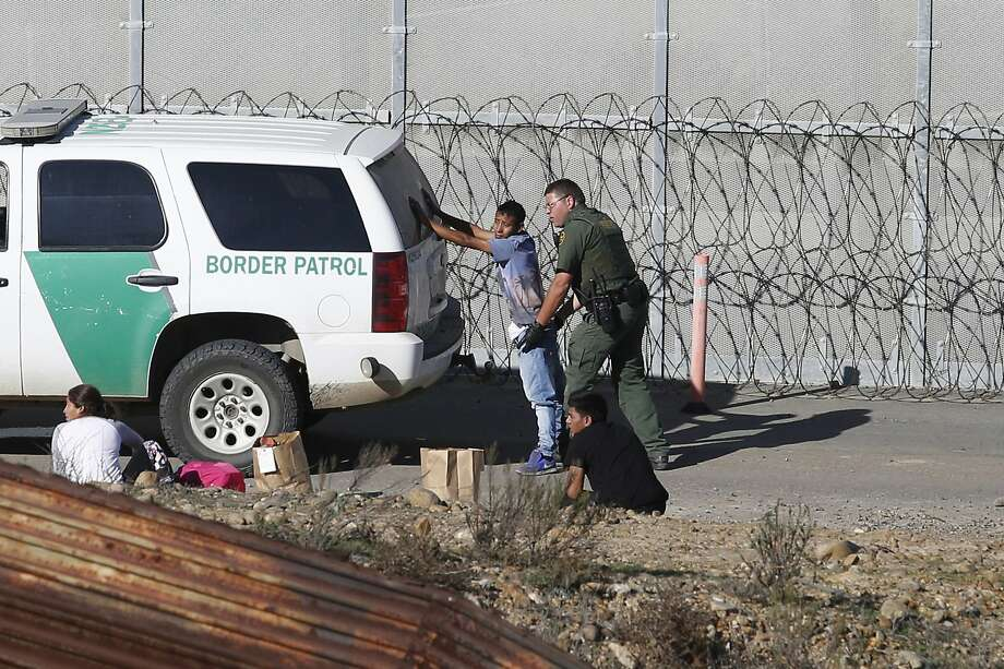 "FILE - In this Dec. 15, 2018, file photo, Honduran asylum seekers are taken into custody by U.S. Border Patrol agents after the group crossed the U.S. border wall into San Diego, Calif., seen from Tijuana, Mexico. Detained asylum seekers who have shown they have a credible fear of returning to their country will no longer be able to ask a judge to grant them bond. U.S. Attorney General William Barr decided Tuesday, April 16, 2019, that asylum seekers who clear a ""credible fear"" interview and are facing removal don't have the right to be released on bond while their cases are pending and will have to wait in detention until their case is adjudicated.  (AP Photo/Moises Castillo, File) Photo: Moises Castillo, Associated Press"