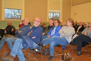About 100 residents atttended the Inland Wetlands Commission public hearing on the proposed development of 120 apartments in Greenbrier Estates.