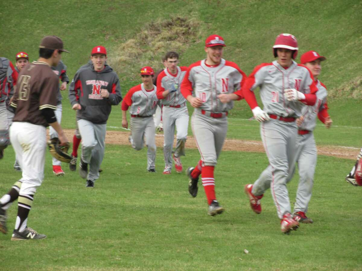 Northwestern celebrates a come-from-behind win over Thomaston in the bottom of the seventh inning on Tuesday, April 16, 2019 at Northwestern High School.