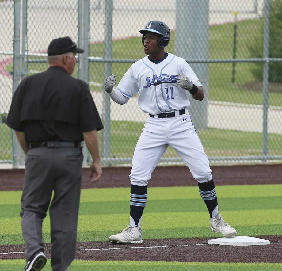 Johnson's Donavan Sanders (11) reacts after bringing in two runs on a triple against South San in District 27-6A baseball on Tuesday, Apr. 16, 2019. Both teams are trying to keep pace with first place Reagan. Johnson shut out South San, 7-0. (Kin Man Hui/San Antonio Express-News) Photo: Kin Man Hui, Staff / Staff Photographer / ©2019 San Antonio Express-News