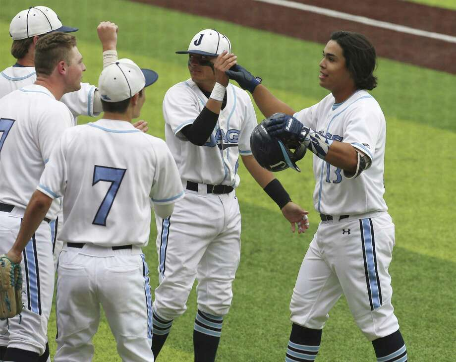 Johnson's Dominic Tamez (13) gets congratulated after slamming a two-run homerun in the sixth inning against South San in District 27-6A baseball on Tuesday, Apr. 16, 2019. Both teams are trying to keep pace with first place Reagan. Johnson shut out South San, 7-0. (Kin Man Hui/San Antonio Express-News) Photo: Kin Man Hui, Staff / Staff Photographer / ©2019 San Antonio Express-News