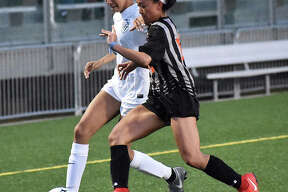 Edwardsville's Katrina Agustin plays defense early in the second half against Belleville East in Edwardsville.