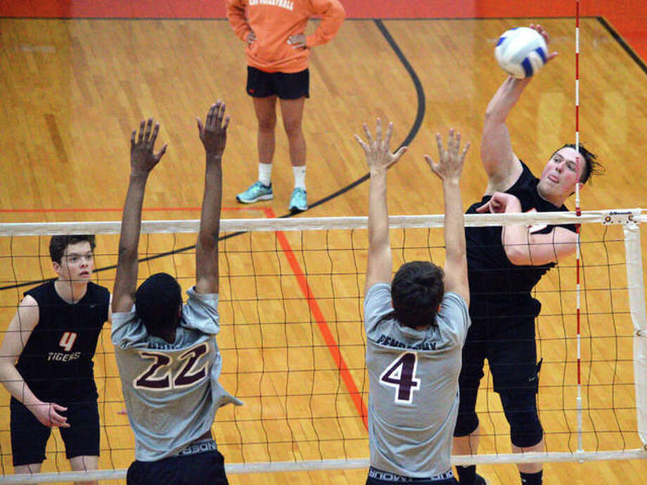 Edwardsville junior Josh Whittenburg, right, goes up for a kill during the second game of Tuesday's Southwestern Conference match against Belleville West at Lucco-Jackson Gymnasium. Photo: Scott Marion/The Intelligencer