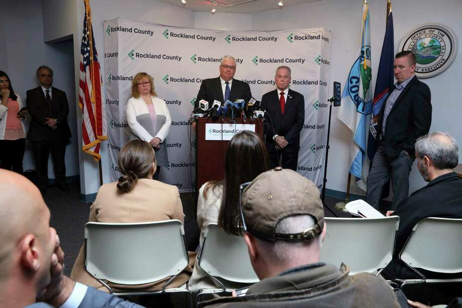 Attorney Thomas Humbach, center, speaks, as County Executive Ed Day, right, and Rockland County Commissioner of Health Dr. Patricia Schnabel Ruppert, left, listen during a news conference Tuesday, April 16, 2019 in New City, N.Y., on a new measles exclusion order that mandates anyone with measles to stay home, and those exposed to stay out of public spaces throughout Rockland county. (Tania Savayan/The Journal News via AP) Photo: Tania Savayan / The Journal News