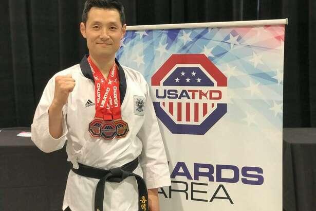 Master Seongho Hong of Hong's Olympic Taekwondo Academy in New Milford recently earned three medals at the US Open Taekwondo Championships.