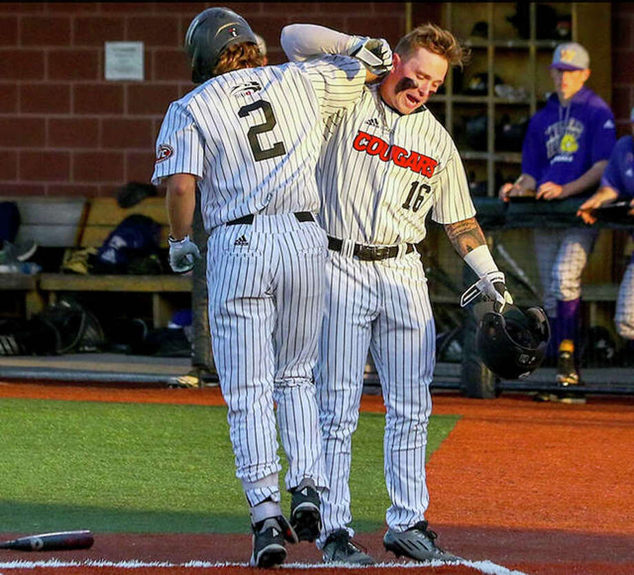 SIUE's Brock Weimer (2) and teammate Dustin Woodcock celebrate at home plate during the Cougars' 13-3 victory over Western Illinois University Tuesday night at SIUE. Photo: SIUE Athletics