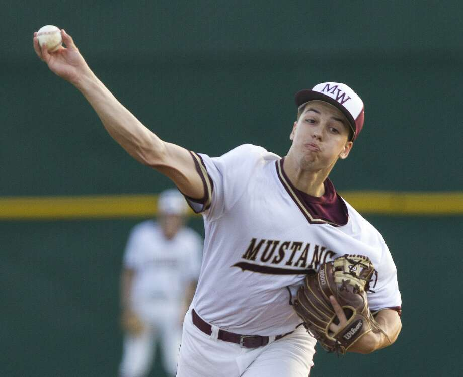 Magnolia West starting pitcher Connor Phillips (9) throws during the first innign of a District 19-5A high school baseball game at Magnolia West High School, Tuesday, April 16, 2019, in Magnolia. Photo: Jason Fochtman, Houston Chronicle / Staff Photographer / © 2019 Houston Chronicle
