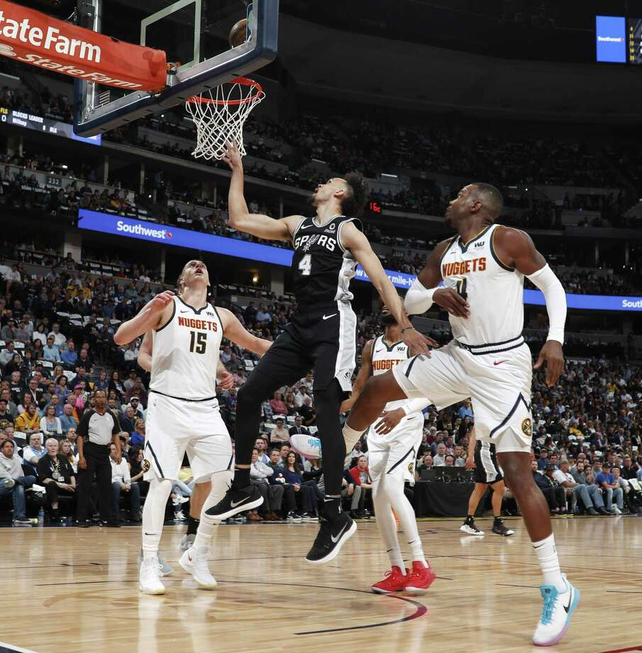 Derrick White gets to the hoop in the first half. White finished with 17 points on 7-of-11 shooting, but went scoreless in the decisive fourth quarter and without an assist the whole game. Photo: David Zalubowski /Associated Press / Copyright 2019 The Associated Press. All rights reserved.