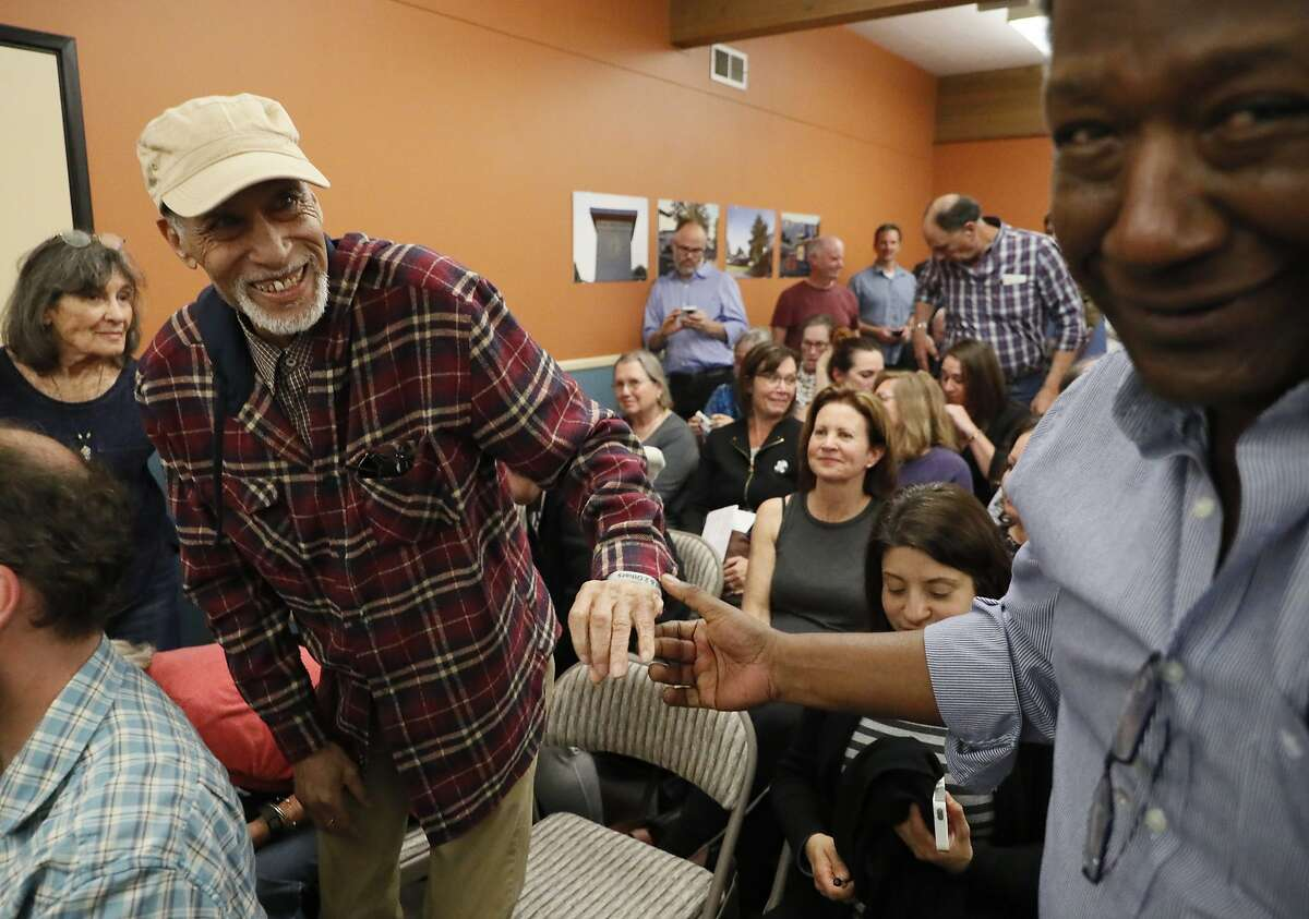 Kerry Pierson, activist who first suggested the name change, is congratulated by Julius Mills after the board voted to change the district's name during the Dixie School board meeting on Tuesday, April 16, 2019, in San Rafael, CA.