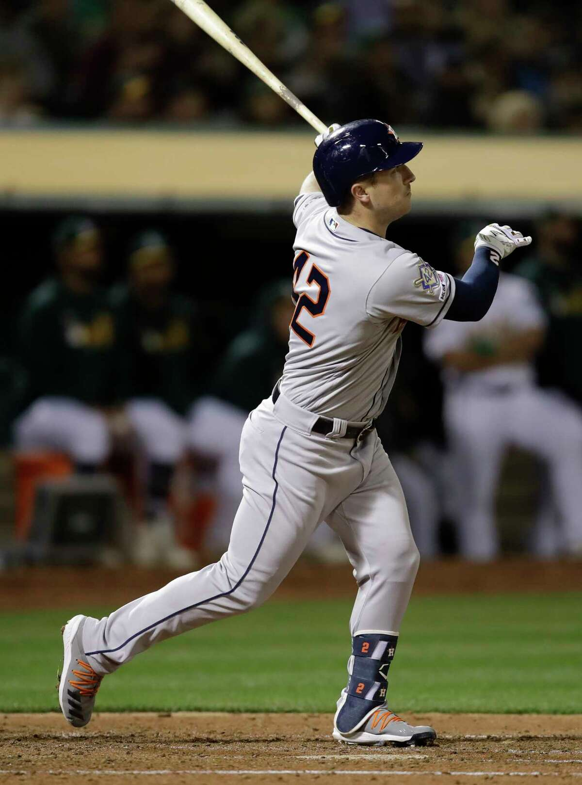 Houston Astros' Alex Bregman watches his grand slam hit off Oakland Athletics pitcher Liam Hendriks in the fourth inning of a baseball game Tuesday, April 16, 2019, in Oakland, Calif. (AP Photo/Ben Margot)