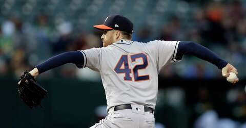 1ac567801 Houston Astros pitcher Collin McHugh works against the Oakland Athletics in  the first inning of a