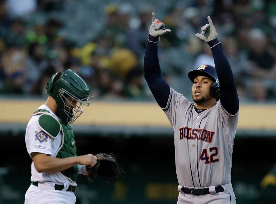 Houston Astros' George Springer, right, celebrates after hitting a home run off Oakland Athletics' Marco Estrada in the first inning of a baseball game, Tuesday, April 16, 2019, in Oakland, Calif. (AP Photo/Ben Margot) Photo: Ben Margot, Associated Press / Copyright 2019 The Associated Press. All rights reserved.