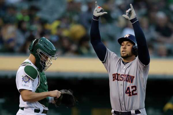 Houston Astros' George Springer, right, celebrates after hitting a home run off Oakland Athletics' Marco Estrada in the first inning of a baseball game, Tuesday, April 16, 2019, in Oakland, Calif. (AP Photo/Ben Margot)