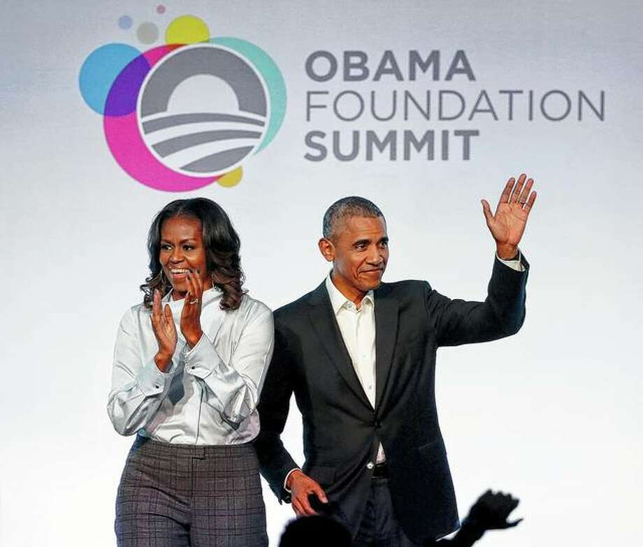 Former President Barack Obama (right) and former first lady Michelle Obama arrive in October 2017 for the first session of the Obama Foundation Summit in Chicago. Obama's foundation collected contributions of more than $1 million from 11 firms and individuals in the first three months of 2019, records show. The Obama Foundation's donor list, which is updated quarterly, included the AT&T Foundation and the W.K. Kellogg Foundation, along with other family trusts and foundations. Photo: Charles Rex Arbogast | Associated Press