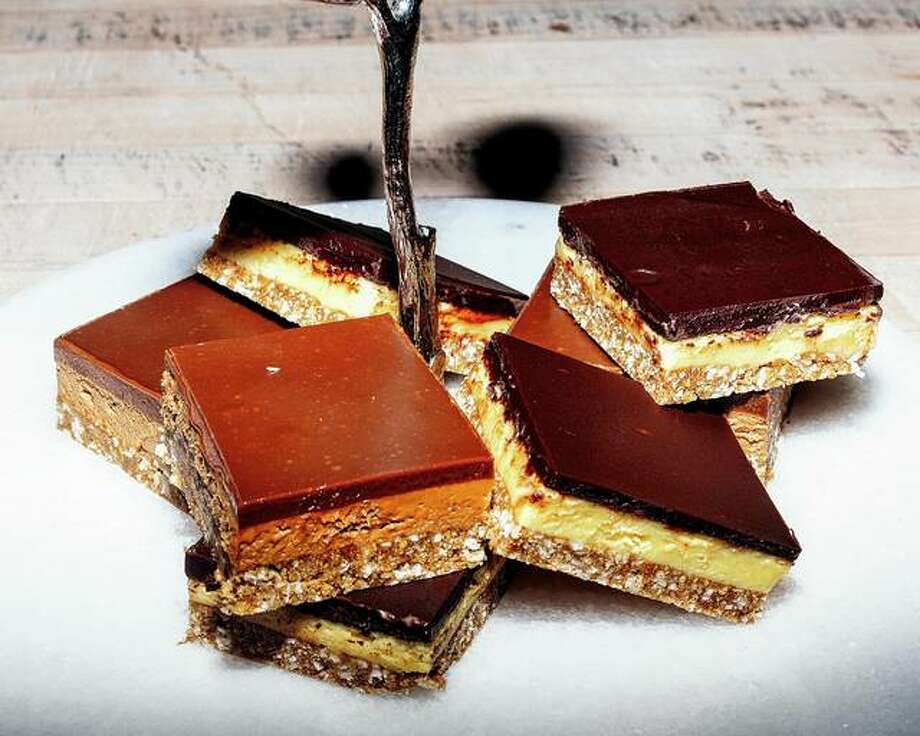 Cappuccino and traditional Nanaimo bars are prepared by Susan Mendelson of Vancouver. Mendelson's recipe helped make the Nanaimo bar — coconut and chopped walnuts bound together by a buttery silt of cocoa and crushed graham crackers, below yellow buttercream and a brittle chocolate — a national staple in Canada. Photo: Alana Paterson | The New York Times