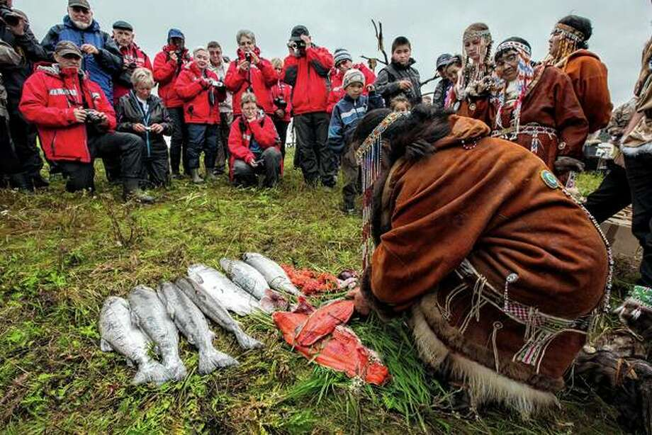 Indigenous fishermen share their catch with passengers traveling with Silversea Cruises in Tymlat, Kamchatka, Russia. In the footsteps of Anthony Bourdain, companies big and small are steering travelers to out-of-the-way eating experiences while trying not to trample on food traditions. Photo: Richard Sidey Via The New York Times