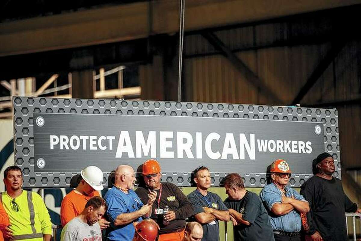 Steelworkers wait for President Donald Trump to arrive on July 26 at U.S. Steel's Granite City Works plant in Granite City.