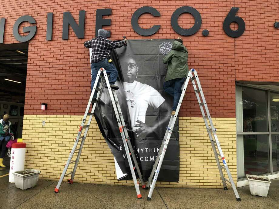 "A poster of Hillhouse senior Makayla Dawkins, created as part of the ongoing ""iMatter"" youth empowerment project, was affixed to the Dixwell firehouse Monday in New Haven. Photo: Ben Lambert / Hearst Connecticut Media /"