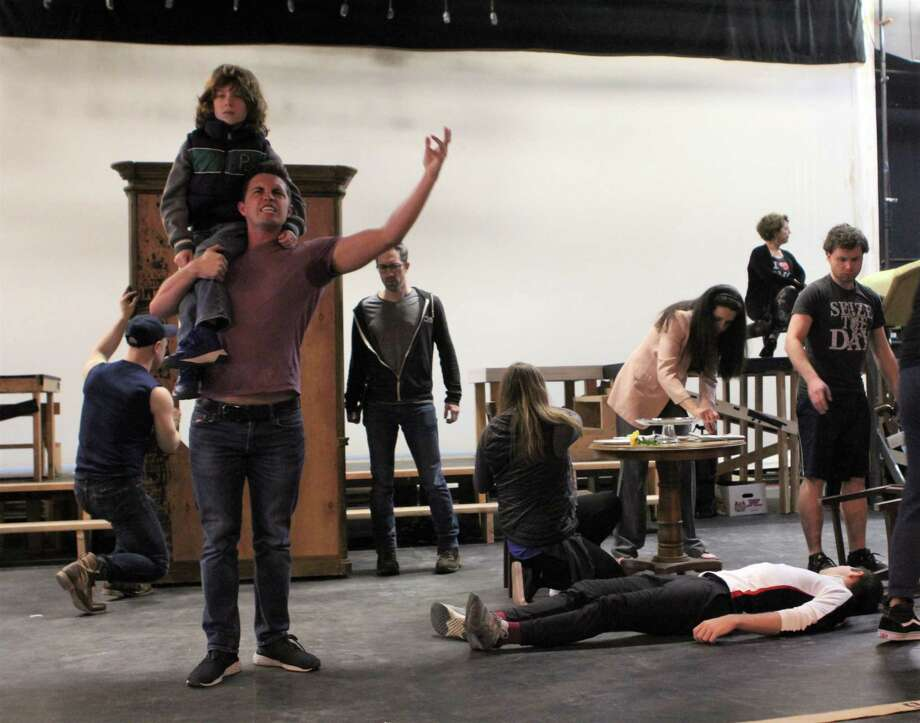Garrison Carpenter as Tommy andRJ Vercellone as young Tommy in a rehearsal moment. Photo: Paul Roth / Contributed Photo
