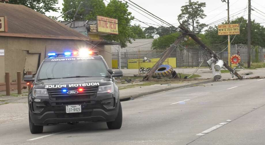 North Shepherd Drive is closed by Houston police after a pickup truck crashed into power lines, knocking power out to area homes and businesses Wednesday, April 17, 2019. Photo: Jay R. Jordan