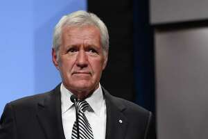 """FILE - MARCH 06: """"Jeopardy!"""" host Alex Trebek announced March 6, 2019 that he has been diagnosed with stage 4 pancreatic cancer. LAS VEGAS, NV - APRIL 09: """"Jeopardy!"""" host Alex Trebek speaks as he is inducted into the National Association of Broadcasters Broadcasting Hall of Fame during the NAB Achievement in Broadcasting Dinner at the Encore Las Vegas on April 9, 2018 in Las Vegas, Nevada. NAB Show, the trade show of the National Association of Broadcasters and the world's largest electronic media show, runs through April 12 and features more than 1,700 exhibitors and 102,000 attendees. (Photo by Ethan Miller/Getty Images)"""