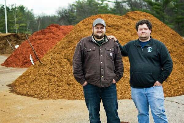 Midland Mulch Supply co-owners Joel Marshall, left, and Mike Cohoon, right, pose for a portrait at the business, located at 7206 W. Wackerly Street, on Friday, April 12. (Katy Kildee/kkildee@mdn.net)