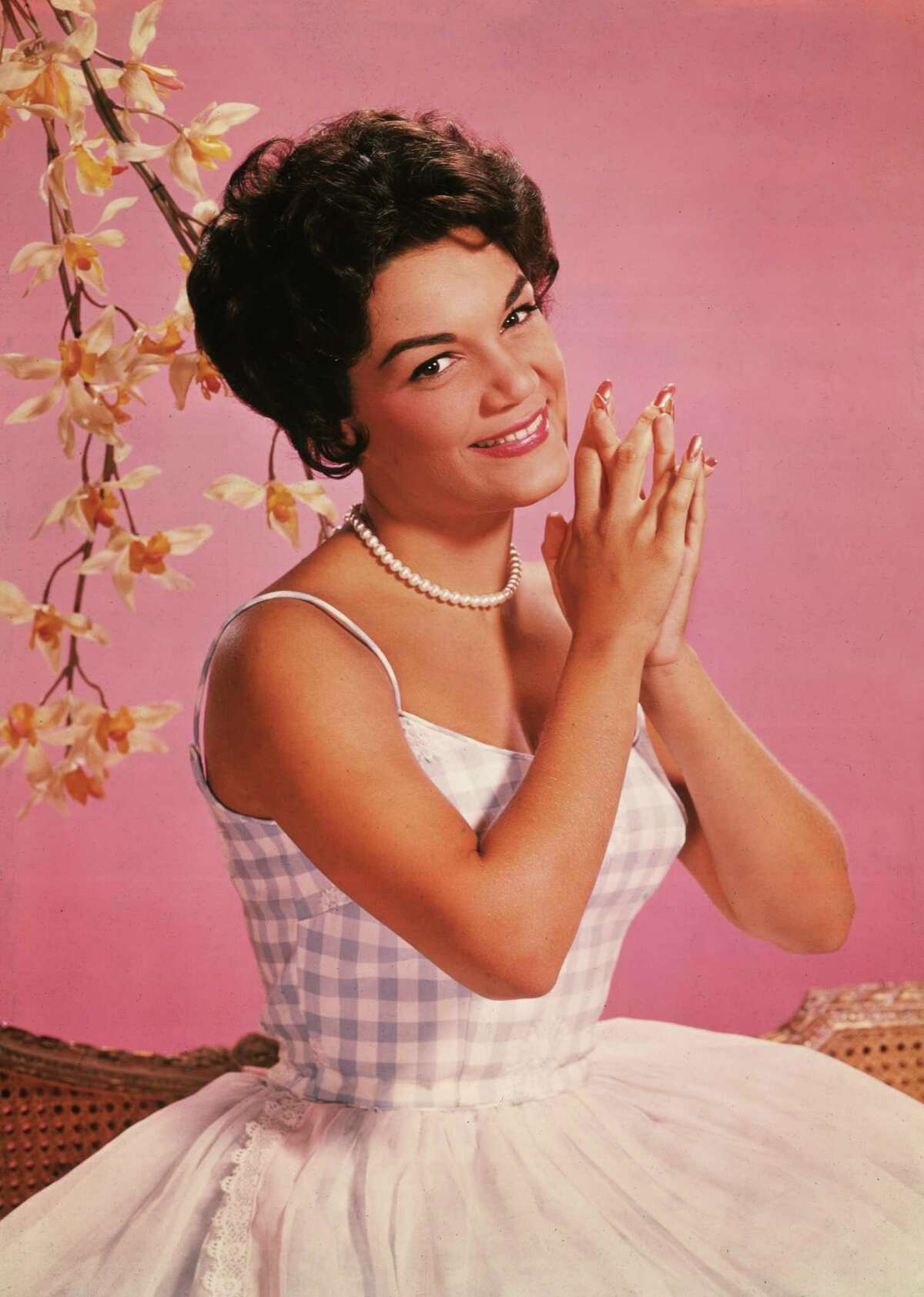 Studio portrait of American singer Connie Francis wearing a lavender and white spaghetti-strap dress in (Photo by Archive Photos/Getty Images)