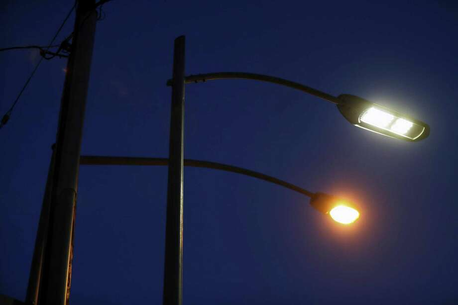 LED street light and a tungsten street light seen side by side in this file photo. Photo: Scott Strazzante / The Chronicle / **MANDATORY CREDIT FOR PHOTOG AND SF CHRONICLE/NO SALES/MAGS OUT/TV