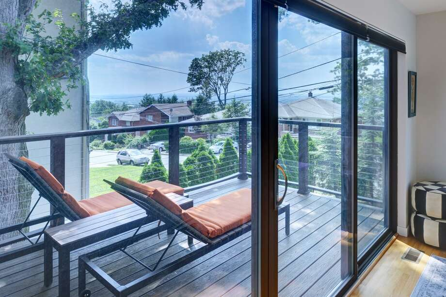 An alternative to picket rails, cable rails don't occupy much space, opening up the view from both inside and out. Photo: Contributed Photo / Ichael Slack Via Joshua Zinder Architecture + Design / MICHAEL SLACK