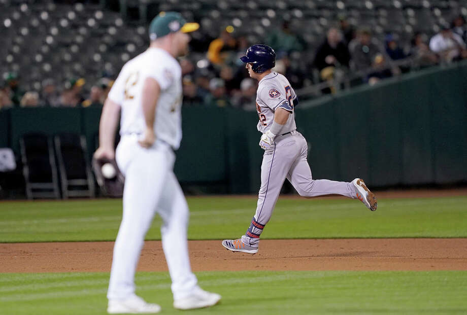 Alex Bregman #2 of the Houston Astros trots around the bases after hitting a grand slam home run off of Liam Hendriks #16 of the Oakland Athletics in the top of the fourth inning of a Major League Baseball game at Oakland-Alameda County Coliseum on April 16, 2019 in Oakland, California. All uniformed players and coaches are wearing number 42 in honor of Jackie Robinson Day. Photo: Thearon W. Henderson/Getty Images / 2019 Getty Images