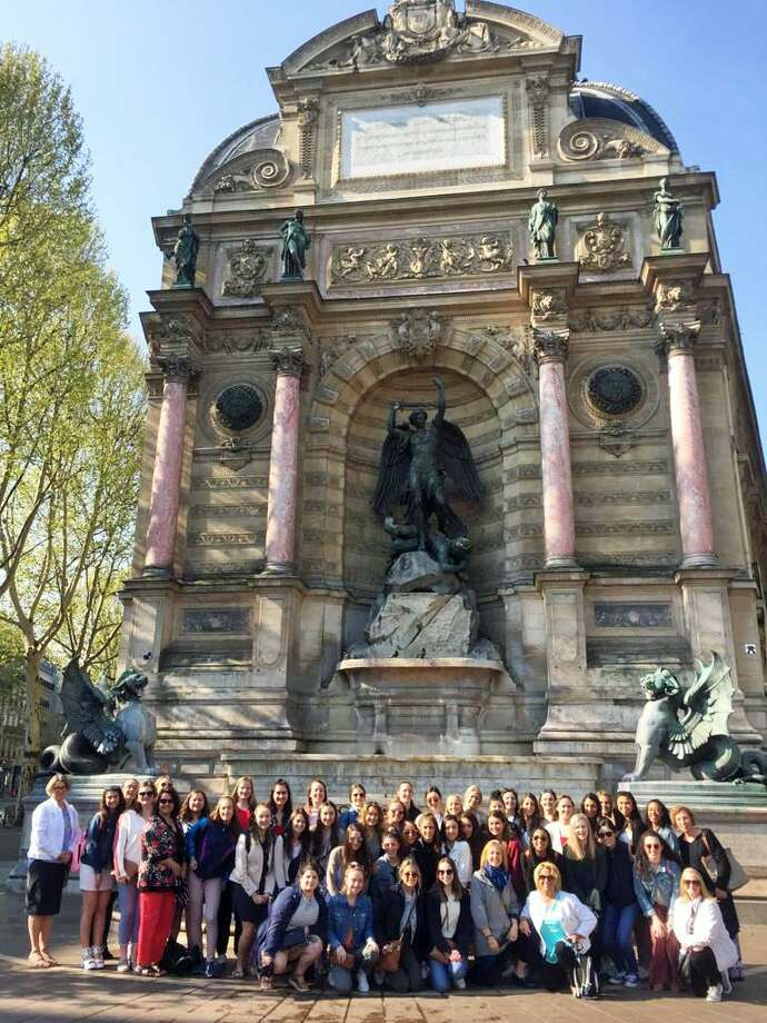 Students and faculty at Mercy High School attended Palm Sunday Mass at Notre Dame Cathedral in Paris a day before the 850-year-old structure was devastated by a massive fire. Here, the group is pictured in front of Fontaine Saint-Michel. Photo: Contributed Photo