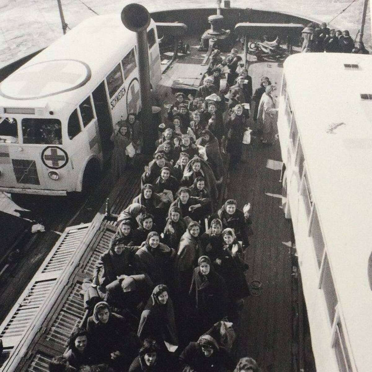 Ravensbruck survivors and the buses arrive on the ferry to Malmo, Sweden. In the desperate, final weeks of WWII, as the German SS acted on orders not to leave one prisoner behind to fall into Allied hands, the Swedish government rushed their famous