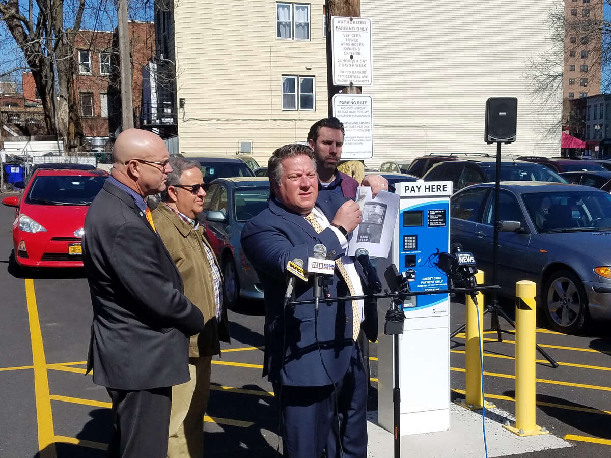County Clerk Bruce Hidley, Albany Common Councilman Richard Conti, County Executive McCoy and Lark Street BID Board Vice Chair and El Loco owner Patrick Noonan announce opening of county-owned parking lot at 208 Washington Ave. in Albany. (Photo courtesy of Albany County)