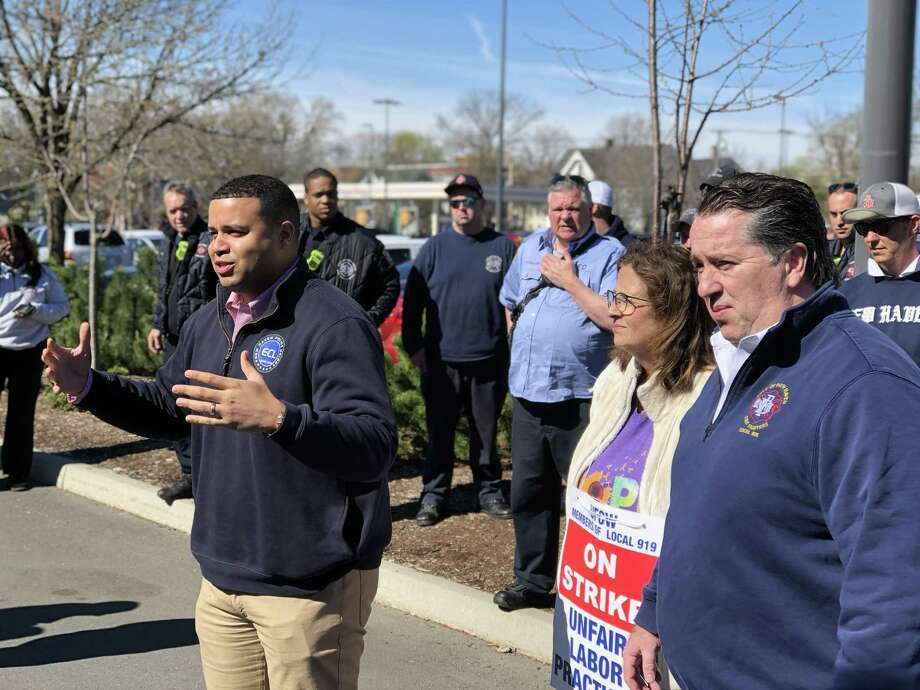 New Haven police and firefighters came out to stand with striking Stop & Shop workers at the store's Whalley Avenue location Wednesday. Here, Florencio Cotto, president of Elm City Local, addresses the workers. Photo: Ben Lambert / Hearst Connecticut Media /