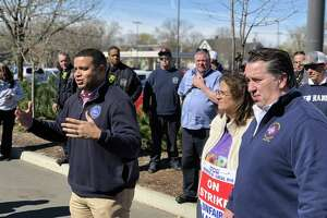 New Haven police and firefighters came out to stand with striking Stop & Shop workers at the store's Whalley Avenue location Wednesday. Here, Florencio Cotto, president of Elm City Local, addresses the workers.