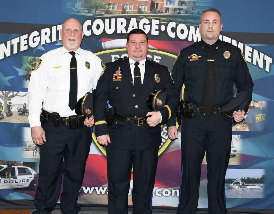 Four West Haven police officers were promoted Tuesday. From left: Capt. Salvatore D'Amato Jr; Deputy Chief Carl V. Flemming; and Lt. Scott Kleinknecht. Not pictured is Sgt. Craig Thompson. Photo: Contributed Photo