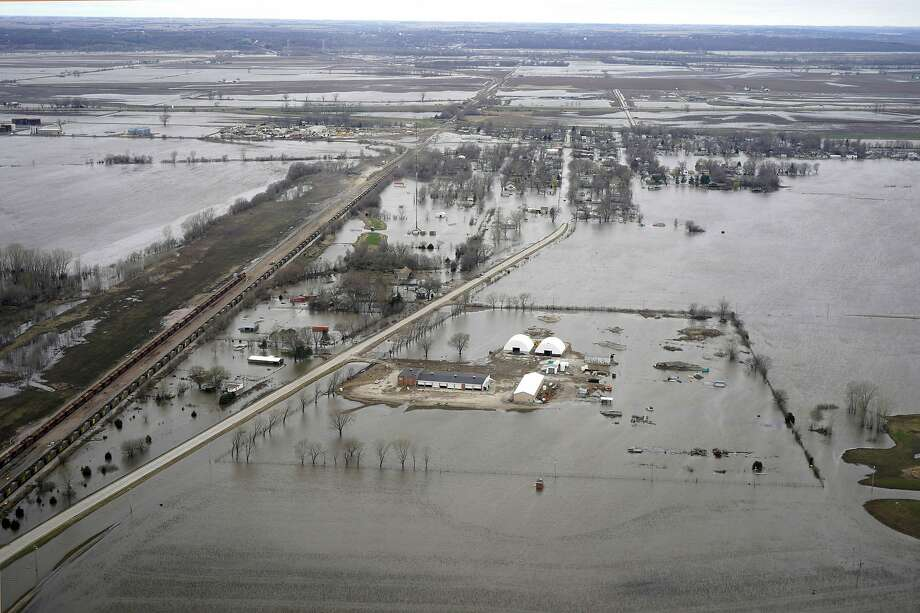 The flooded town of Pacific Junction, Iowa, is seen from above. This spring's flooding along the Missouri River unearthed bitter criticism of the federal agency that manages the river. Photo: Nati Harnik / Associated Press