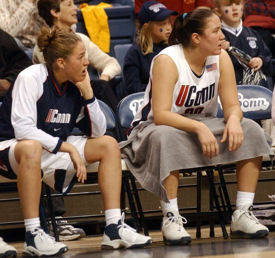 UConn's Ashley Valley, left and her sister Morgan Valley on the bench during a January 2003 game. Morgan Valley was hired as University of Hartford coach Wednesday Photo: Aaron Flaum / New Haven Register