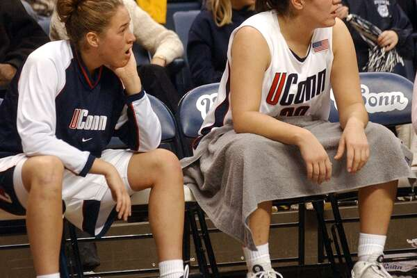 UConn's Ashley Valley, left and her sister Morgan Valley on the bench during a January 2003 game. Morgan Valley was hired as University of Hartford coach Wednesday