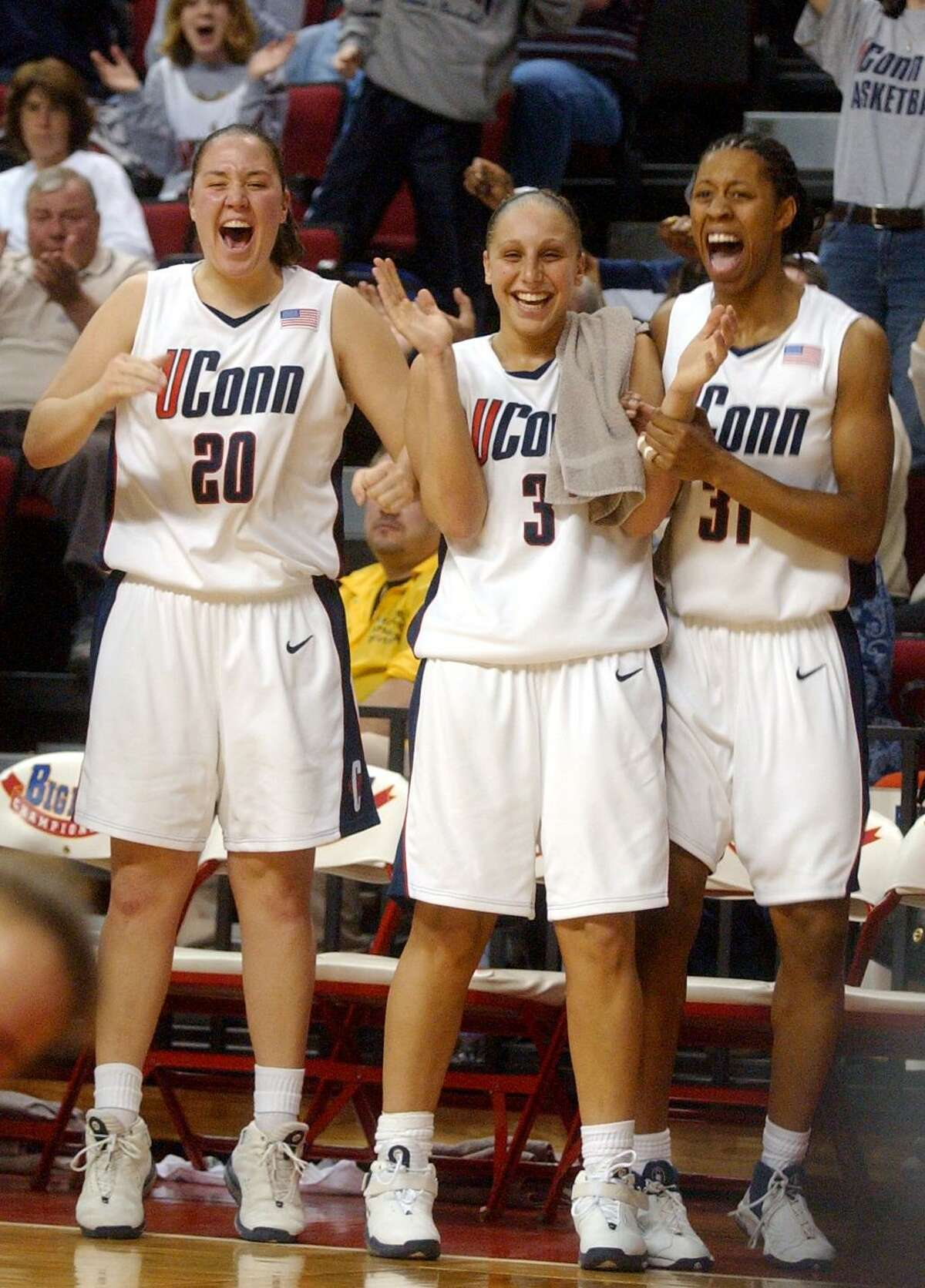 UConn's (20) Morgan Valley, (3) Diana Taurasi, and (31) Jessica Moore celebrates after Ashley Valley got fouled as she made the basket during the Big East quarterfinal against Seton Hall on March 9, 2003.