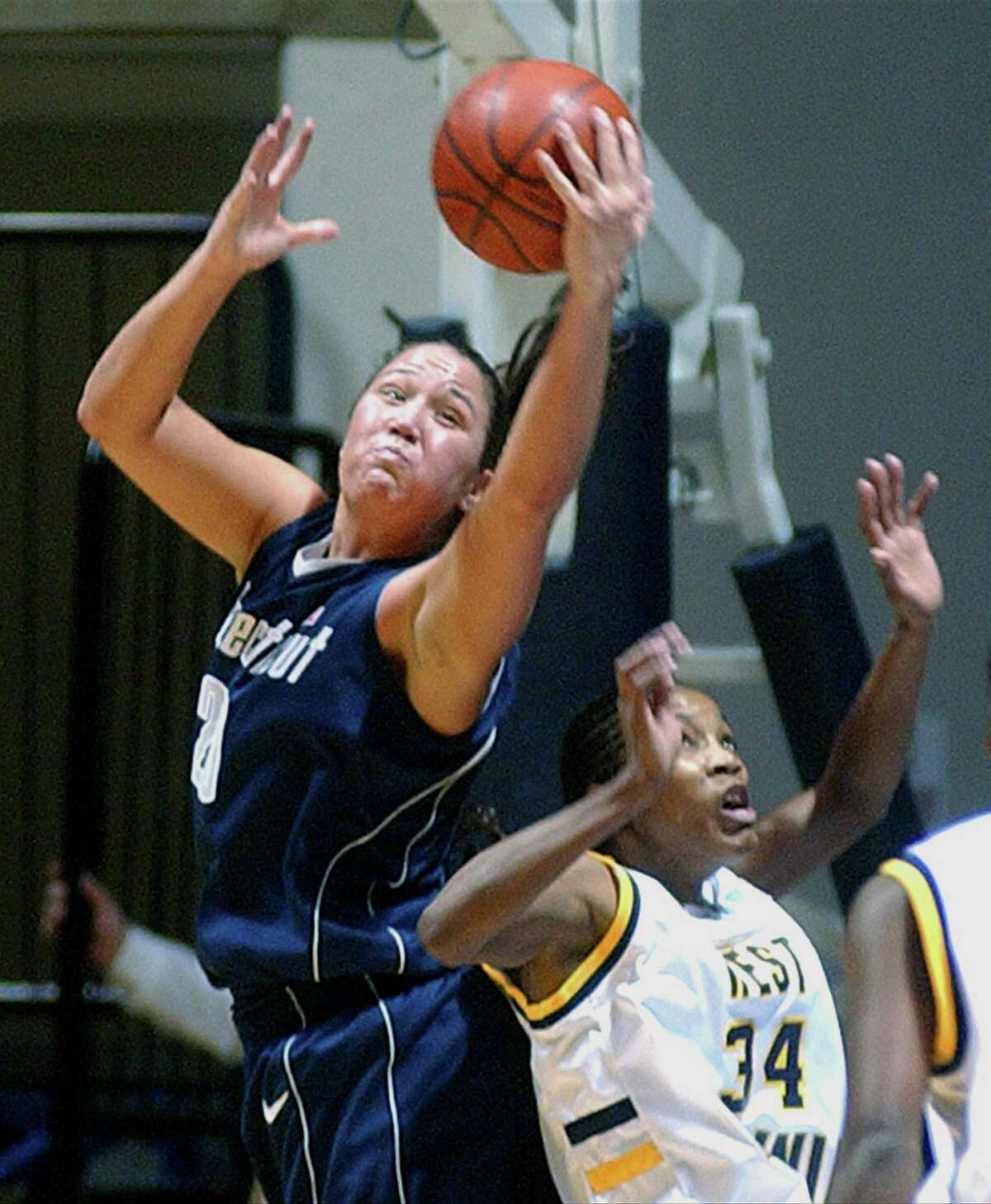 UConn's Morgan Valley, left, rebounds in the first half over West Virginia's Janell Dunlap in Morgantown, W.Va., Wednesday, Jan 7, 2004.