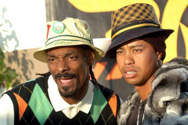 Snoop Dogg and Tiger Woods during Spike TV's 2nd Annual Video Game Awards 2004 Airing on Spike TV Live Tuesday, 9pm Eastern Standard Time -Rehearsals at Barker Hanger in Santa Monica, California, United States. ***Exclusive*** (Photo by Jeff Kravitz/FilmMagic, Inc)