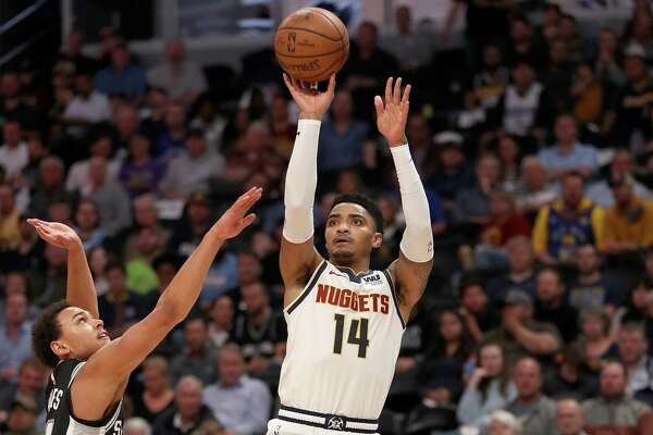DENVER, COLORADO - APRIL 16: Gary Harris #14 of the Denver Nuggets puts up a shot over Bryn Forbes #11 of San Antonio Spurs in the third quarter during game two of the first round of the NBA Playoffs at the Pepsi Center on April 16, 2019 in Denver, Colorado. NOTE TO USER: User expressly acknowledges and agrees that, by downloading and or using this photograph, User is consenting to the terms and conditions of the Getty Images License Agreement. (Photo by Matthew Stockman/Getty Images)