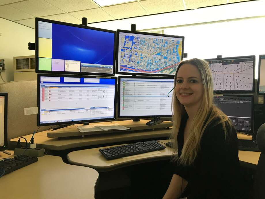 Stamford 911 Telecommunicator of the Year, Erin Walsh, 31, sitting at her cubicle in the 911 Dispatch Center at Government Center. Photo: John Nickerson / Staff