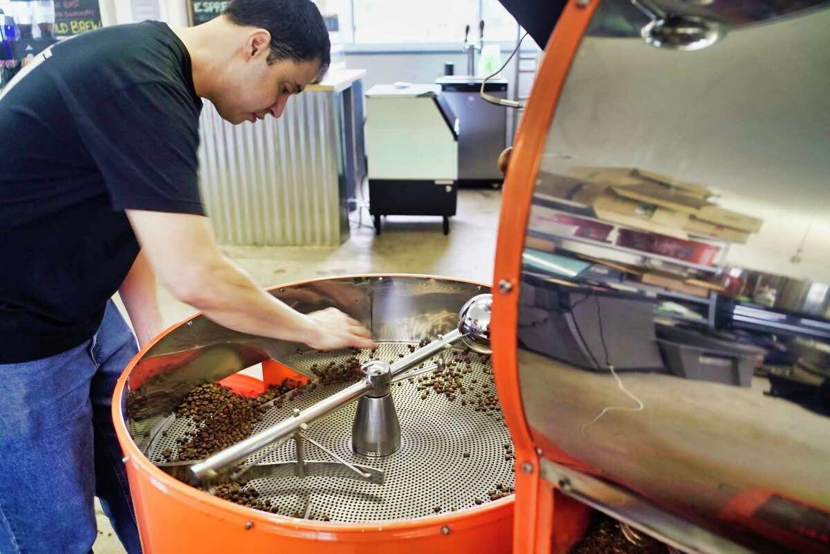 Stephen Pivonka, owner of Brewtus Roasting, collects cooled down roasted coffee beans into a container on Monday, April 15, 2019, in Delmar, N.Y. (Paul Buckowski/Times Union)