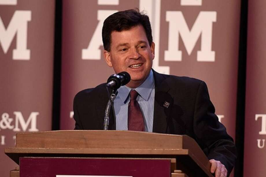 PHOTOS: College basketball's highest-paid coaches  Scott Woodward talks to the media after being named Texas A& athletic director on Jan. 8, 2016, in College Station.  >>>See the salaries for the highest-paid coaches in 2019 ...  Photo: Courtesy Photo, Texas A&M Athletics