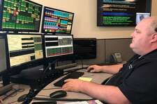 Dispatcher Chris Jensen on the job at SWRCC's new, larger and more technologically advanced facility in the office building at 100 Beard Sawmill Road.