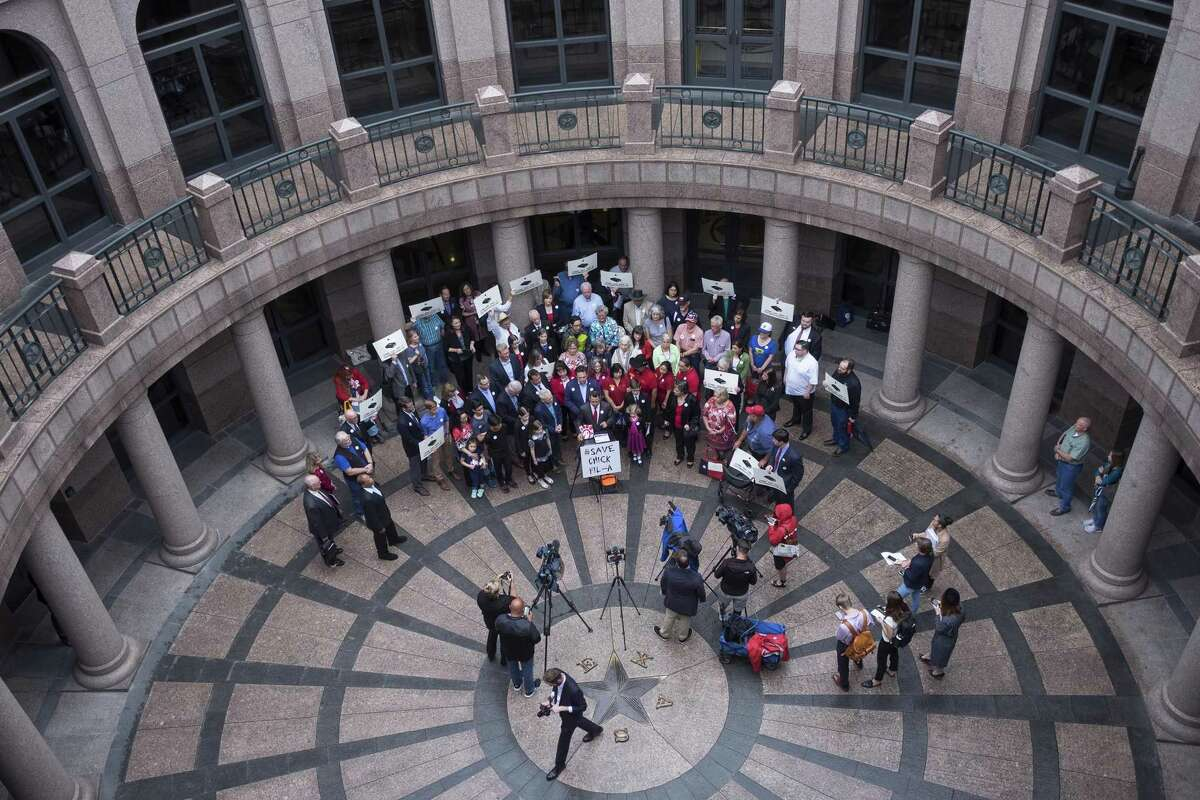 Faith leaders and grassroots activists protesting the San Antonio City Council for preventing Chick-fil-A from opening at the San Antonio International Airport gather at the Texas Capitol on Wednesday